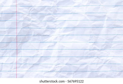 White lined sheet of notepad crumpled paper background