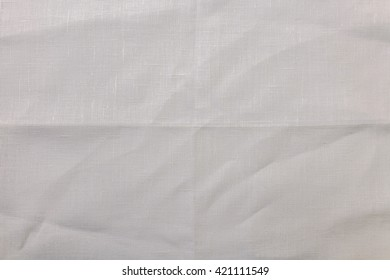White linen tablecloth picnic texture. Textile, napkin, tablecloth. View from above, top. Traditional pattern and color.