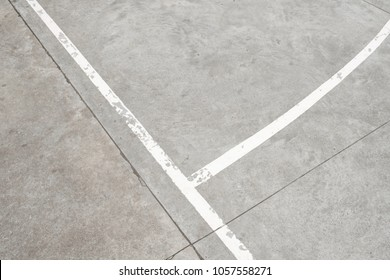 white lines on concrete floor - vintage sport field detail -