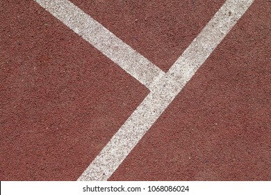 White lines on an outdoor basketball field