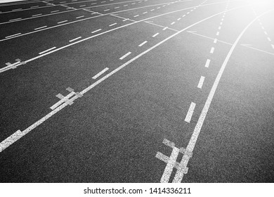 White lines of stadium and texture of running racetrack black rubber racetracks in outdoor stadium are 8 track and green grass field,empty athletics stadium with track.