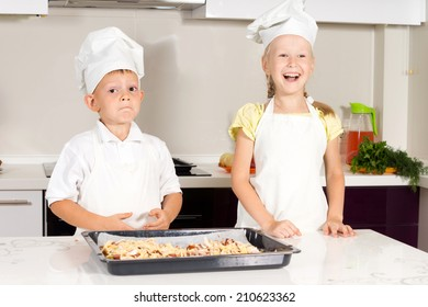 White Little Kids in Chefs Attire Made Tasty Pizza at the Kitchen