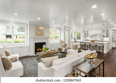 White Living Room and Kitchen in New Luxury Home with Open Concept Floor Plan
