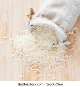 White long rice in small burlap sack