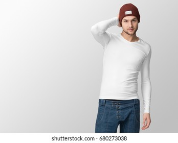 White long sleeve t-shirt on a young man in jeans and hat, isolated, with copy space, mockup.