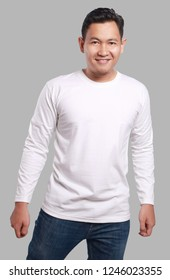 White long sleeved t-shirt mock up, front view, isolated. Male model wear plain white shirt mockup. Long sleeve shirt design template. Blank tees for print