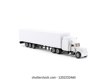 White long truck miniature with a trailer on white background. Clipping path included.