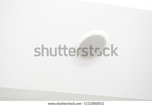 WHITE LOUDSPEAKER MEGAPHONE in building