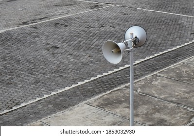 white loudspeakers on a stand