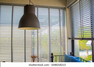 White louvers or Pull up blind use sun protection and beautiful.