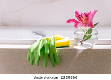White Luxury Bathroom Bathtub Marble Interior Design Cleaning Service Gloves and Sponge Pink Lily Flower in Glass Vase Cleanliness Beauty Concept Copy Space Hygiene No people Housework