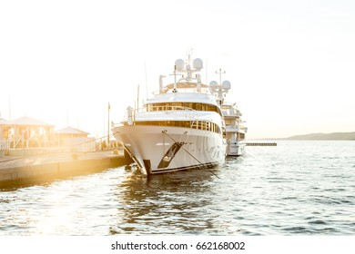 White luxury yacht in the marina of Triest (Italy) at sunset