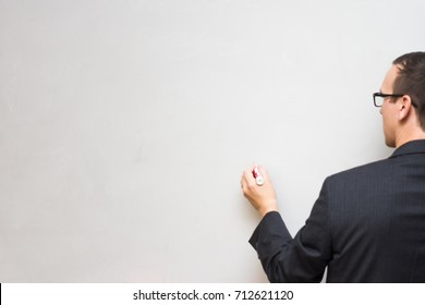 White male draws on empty or blank whiteboard