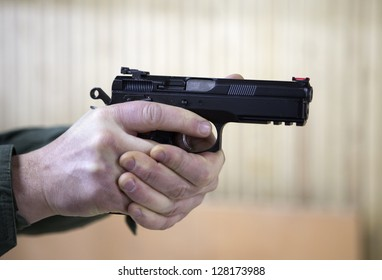 White male hand holding a handgun