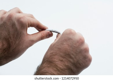 A white male quitting smoking. Breaking a cigarette on an isolated white background