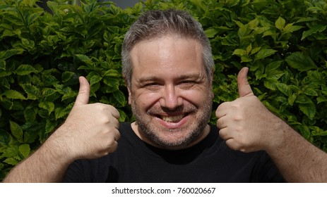 White Male With Thumbs Up