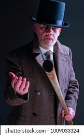 White male Victorian criminal wearing a stovepipe hat holding a pick axe  handle or bat looking menacing.