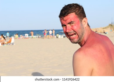 White man at the beach during heatwave