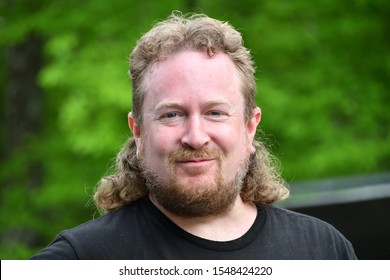 White man with mullet poses for portrait