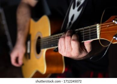 White man playing yellow guitar