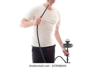 A white man smokes a hookah, holds a in his hand