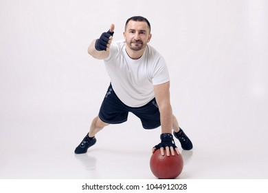 White man training with ball at cyclorama
