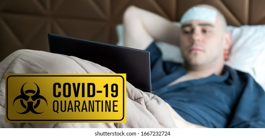 A white man is working from home during Coronavirus or Covid-19 quarantine, coronavirus covid 19 infected patient in coronavirus covid 19 quarantine room with quarantine and outbreak alert sign