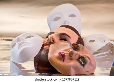 White mannequin head and masks, allegory of falsehood
