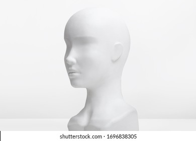 White mannequin head on a white background