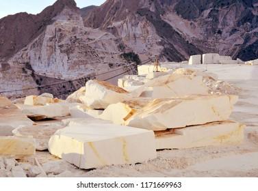 White marble blocks in a Carrara quarry, sunset