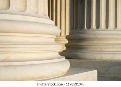 White marble neoclassical columns of the portico of the Supreme Court of the United States building in Washington DC, USA