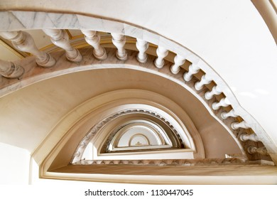 White marble spiral staircase with handrail