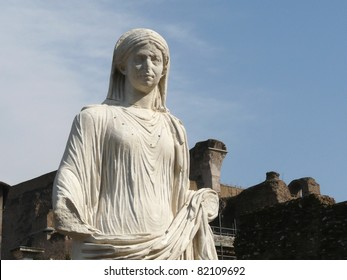 White marble statue of a woman at the Temple of the Vestal Virgins in Roman Forum in Rome, Italy