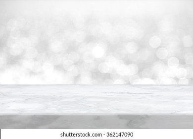 White marble stone countertop on blue bokeh abstract background  - can be used for display or montage your products