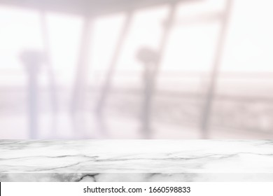 White Marble Table with Blurred White Sightseeing Hall Background, Suitable for Product Presentation Backdrop, Display, and Mock up.
