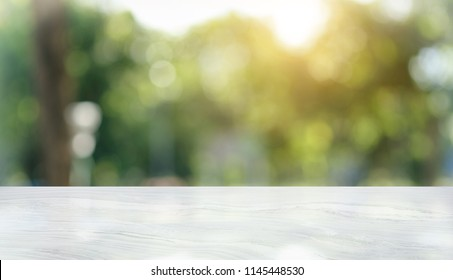 White marble table top on blur Nature and bokeh background. For product or foods montage.