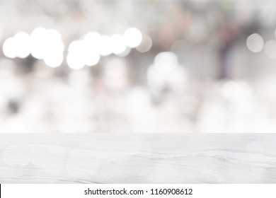 White marble table top on blur coffee shop window background,copy space, For product or foods montage.