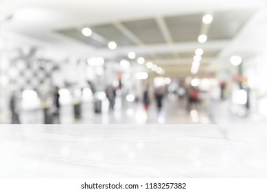 White marble table top on blur coffee shop window background,copy space, For product or foods montage. warm colours sun light.