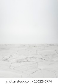 White marble table and whtie wall for background.