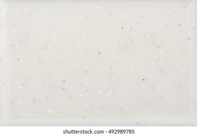 White marble texture with black inclusions. Stone surface background