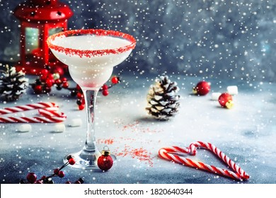 White margarita, Christmas or New Year's winter alcoholic cocktail with rum, coconut and irish cream with red decor in stylish table setting