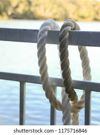 White marine rope over rail with water background