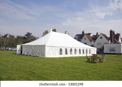 a white marquee on a lawn in summer
