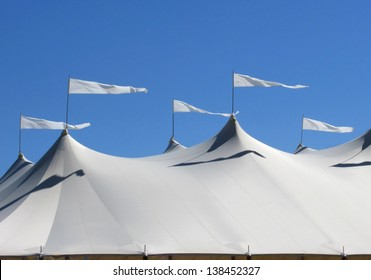 white marquee tent with waving pennant flags