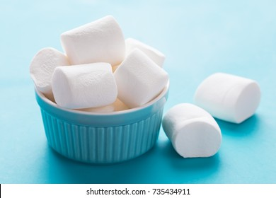 White marshmallows for roasting and hot chocolate in a bowl, close up. Winter food background concept.