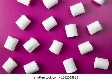 White marshmellow close up on pink background