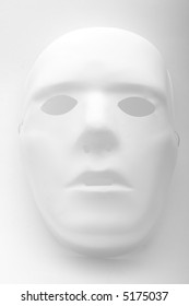 A white mask on a white background