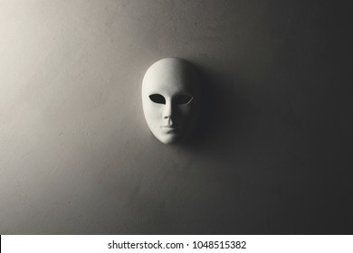 White mask on the dark wall
