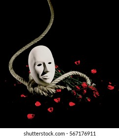 White mask put on rope and red rose on black background, in Concept Love or still Life or Death