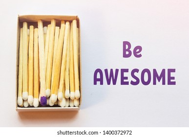 White matches and one match of purple color in a box. Difference, self respect and acceptance concept. Motivational phrase on the image. Opposition, uniqueness, diversity concept. Not like others.